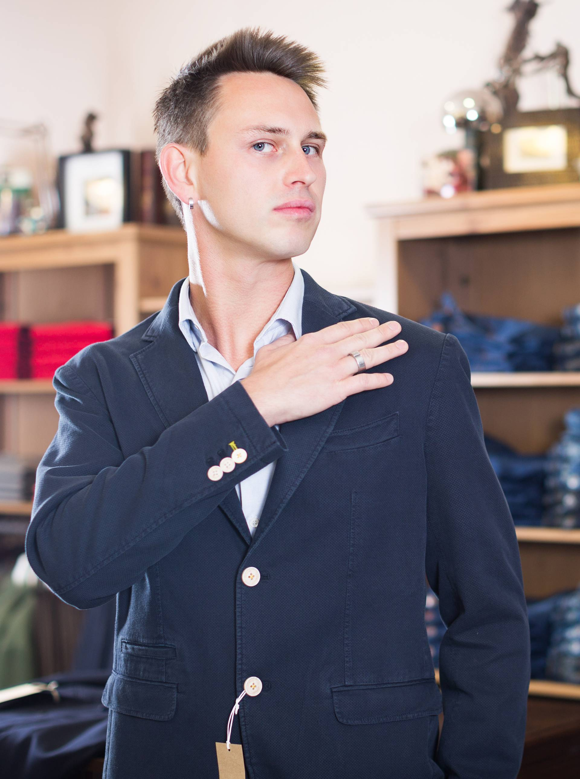 Customer examining suits