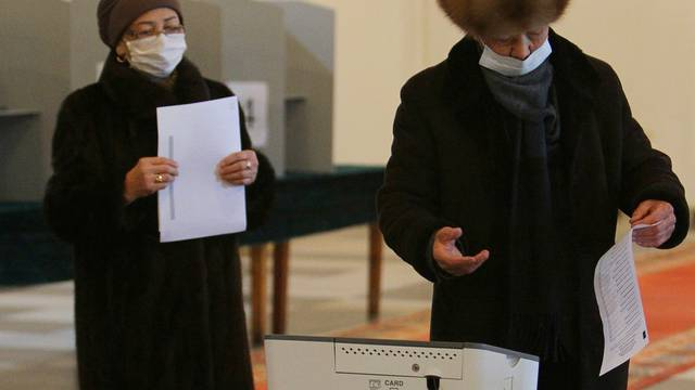 People cast their ballots during a presidential election and constitutional referendum in Bishkek