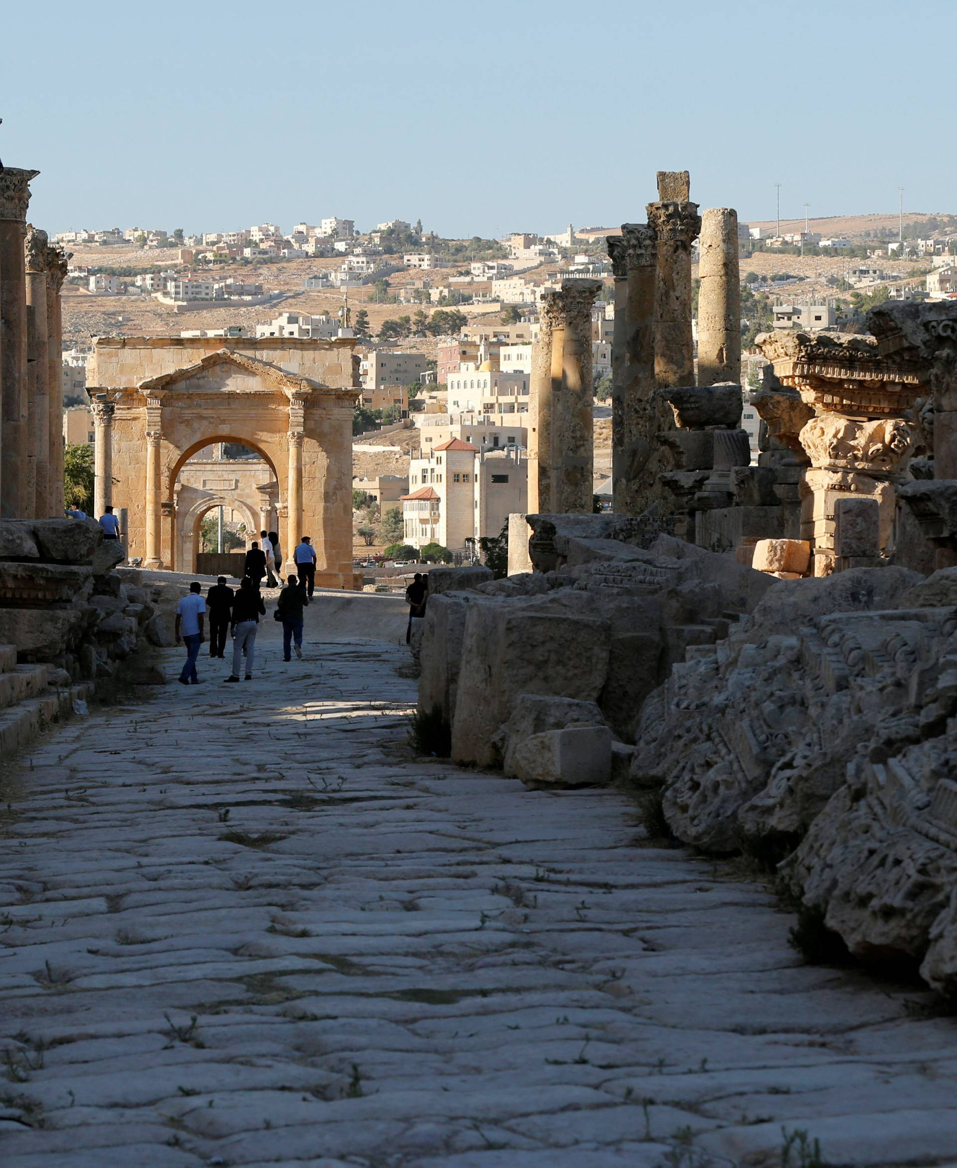 FILE PHOTO: People walk along the ruins of the ancient Roman city of Jerash during the Jerash Festival of Culture and Arts in the ancient city of Jerash