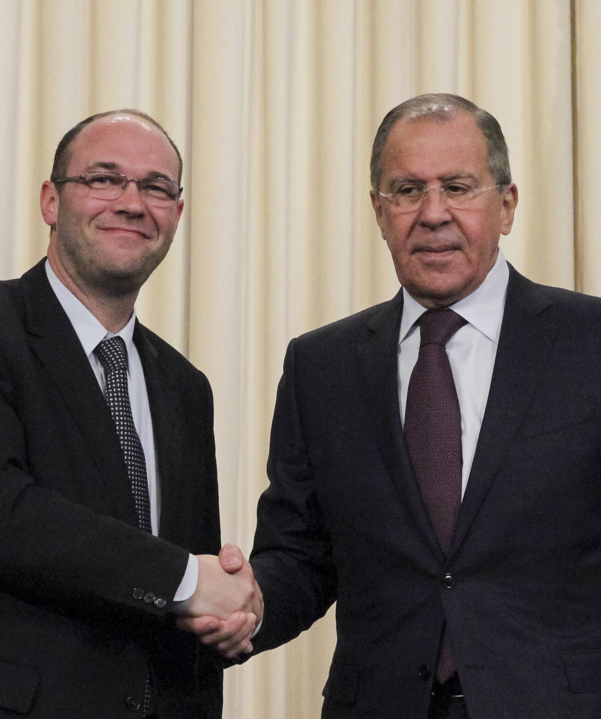 Russian Foreign Minister Sergei Lavrov shakes hands with Croatian Minister of Foreign and European Affairs Davor Ivo Stier during a joint news conference following their meeting in Moscow