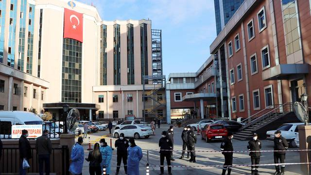Police and security personnel stand guard outside the Sanko University Hospital in Gaziantep