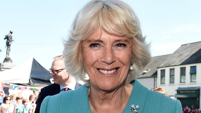 Britain's Camilla Duchess of Cornwall enjoys an ice cream during a visit to Dromore Village in County Down, Northen Ireland