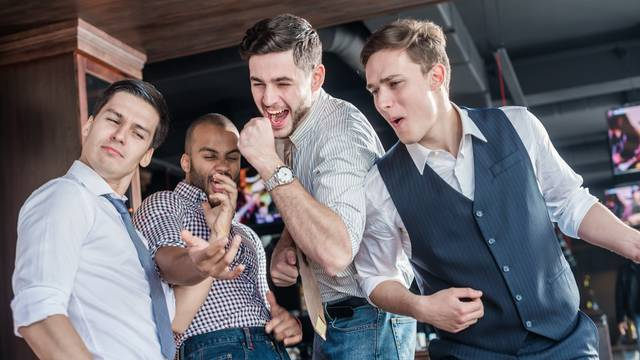 Pick the best of friends. Four men shout and rejoice meeting. Fr