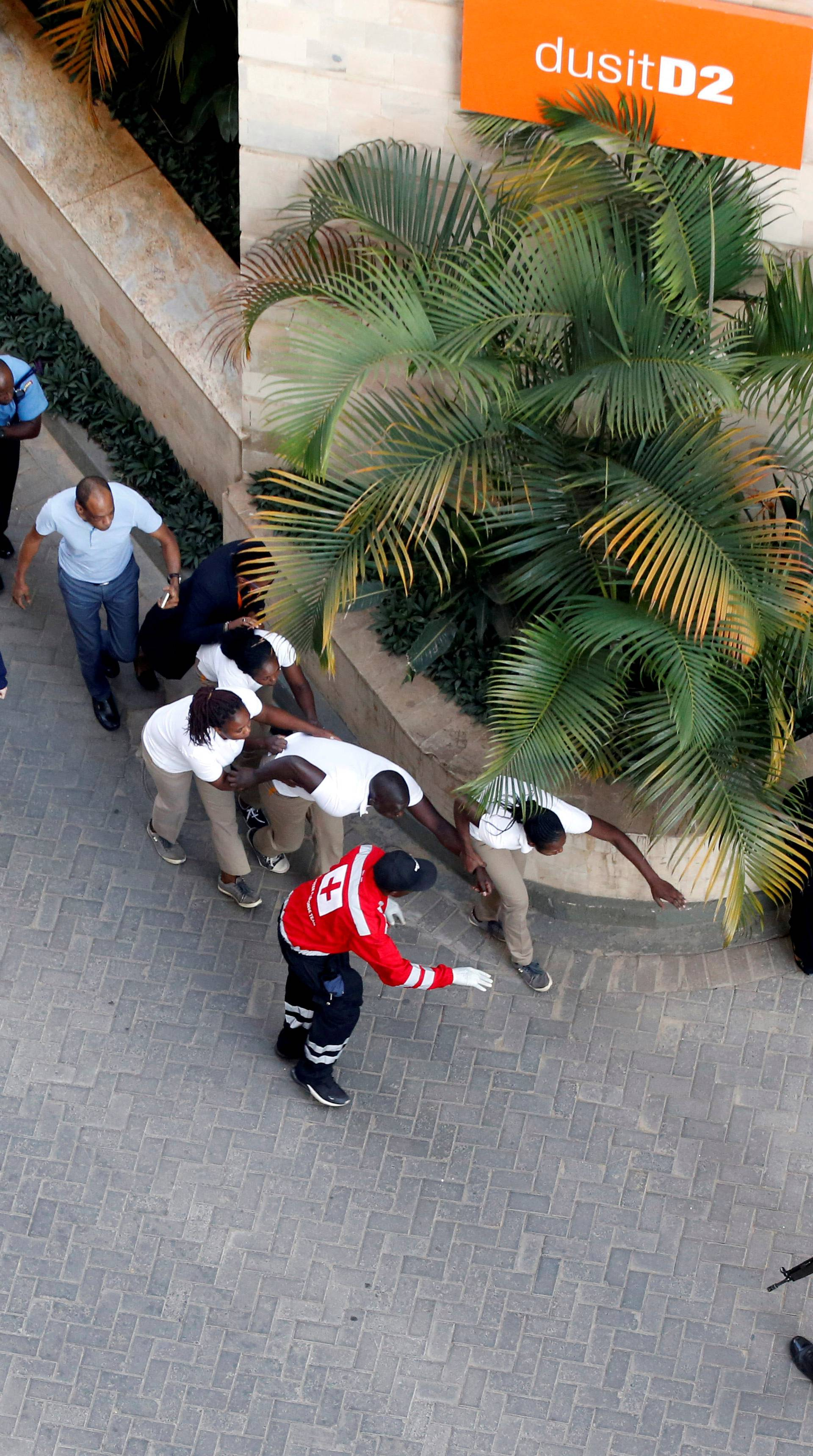 People are evacuated at the scene where explosions and gunshots were heard at the Dusit hotel compound, in Nairobi