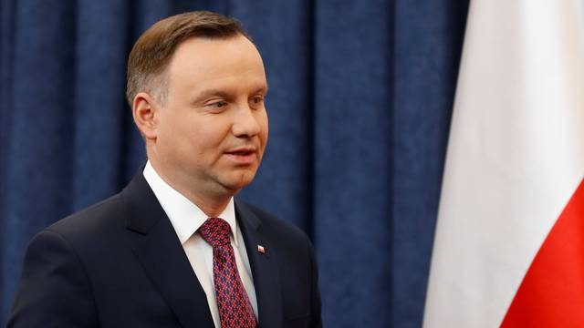 Poland's President Andrzej Duda arrives for a news conference at the Presidential Palace in Warsaw