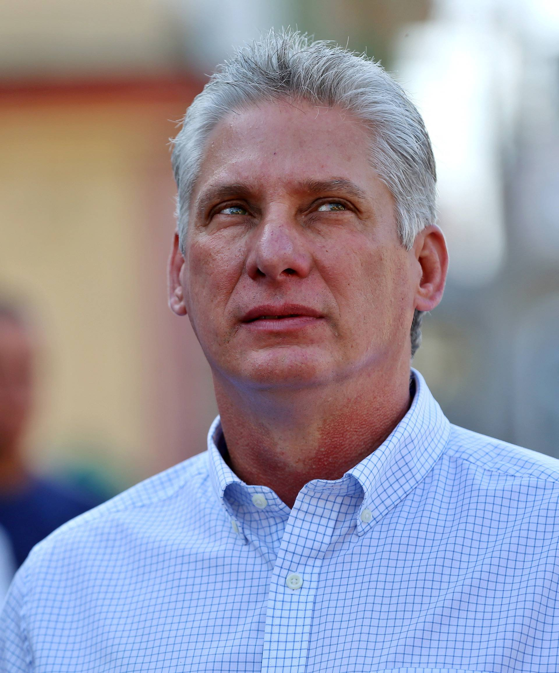 FILE PHOTO: Cuba's First Vice-President Miguel Diaz-Canel stands in line before casting his vote during an election of candidates for the national and provincial assemblies, in Santa Clara