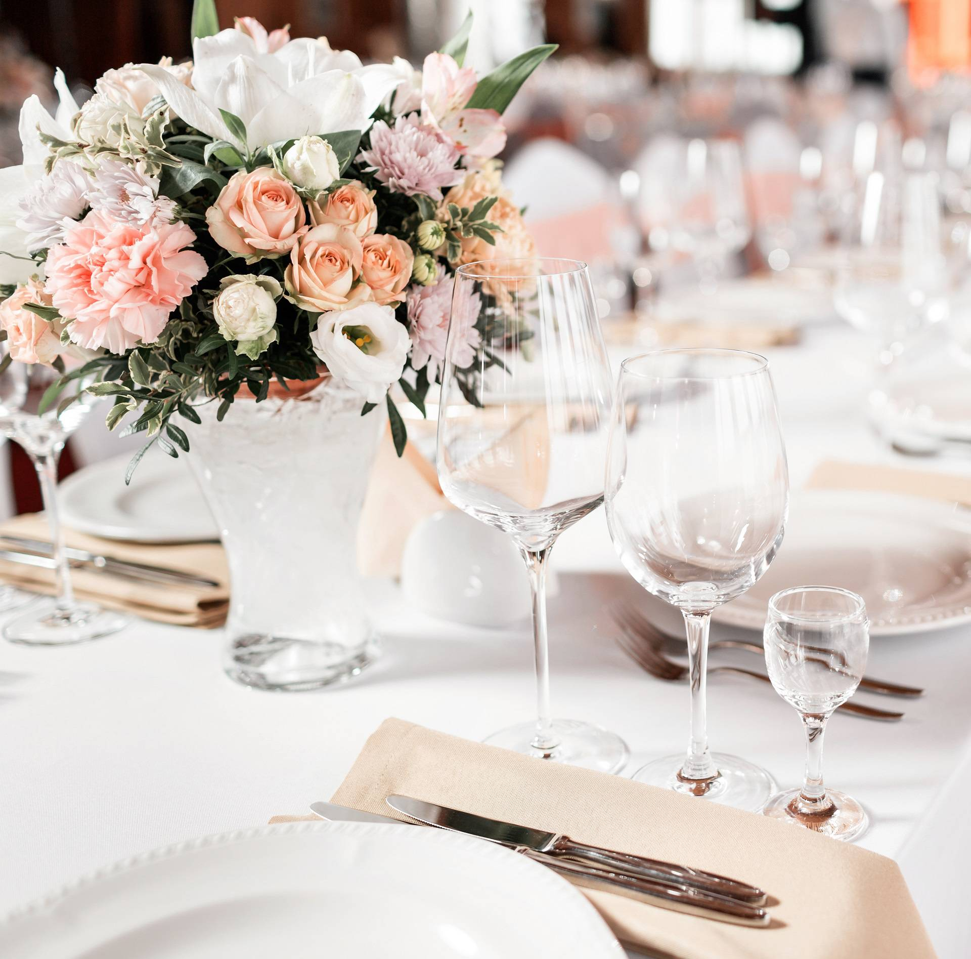 Tables set for an event party or wedding reception. luxury elegant table setting dinner in a restaurant. glasses and dishes.