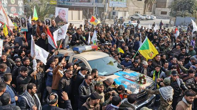 Mourners attend the funeral of the Iranian Major-General Qassem Soleimani and the Iraqi militia commander Abu Mahdi al-Muhandis, in Baghdad