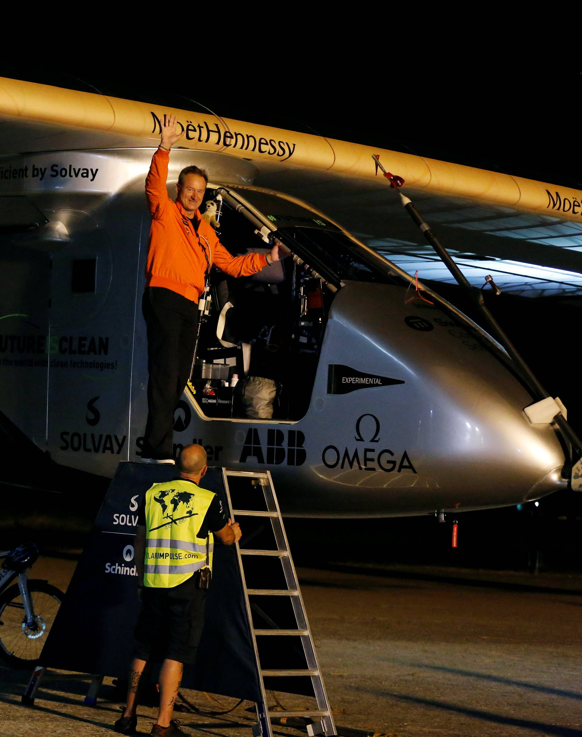 Swiss aviator of the solar-powered plane Solar Impulse 2 Borschberg waves before taking off at San Pablo airport in Seville