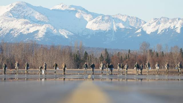 U.S. Air Force airmen search for debris that could damage aircrafts on the fligh tline at Joint Base Elmendorf-Richardson