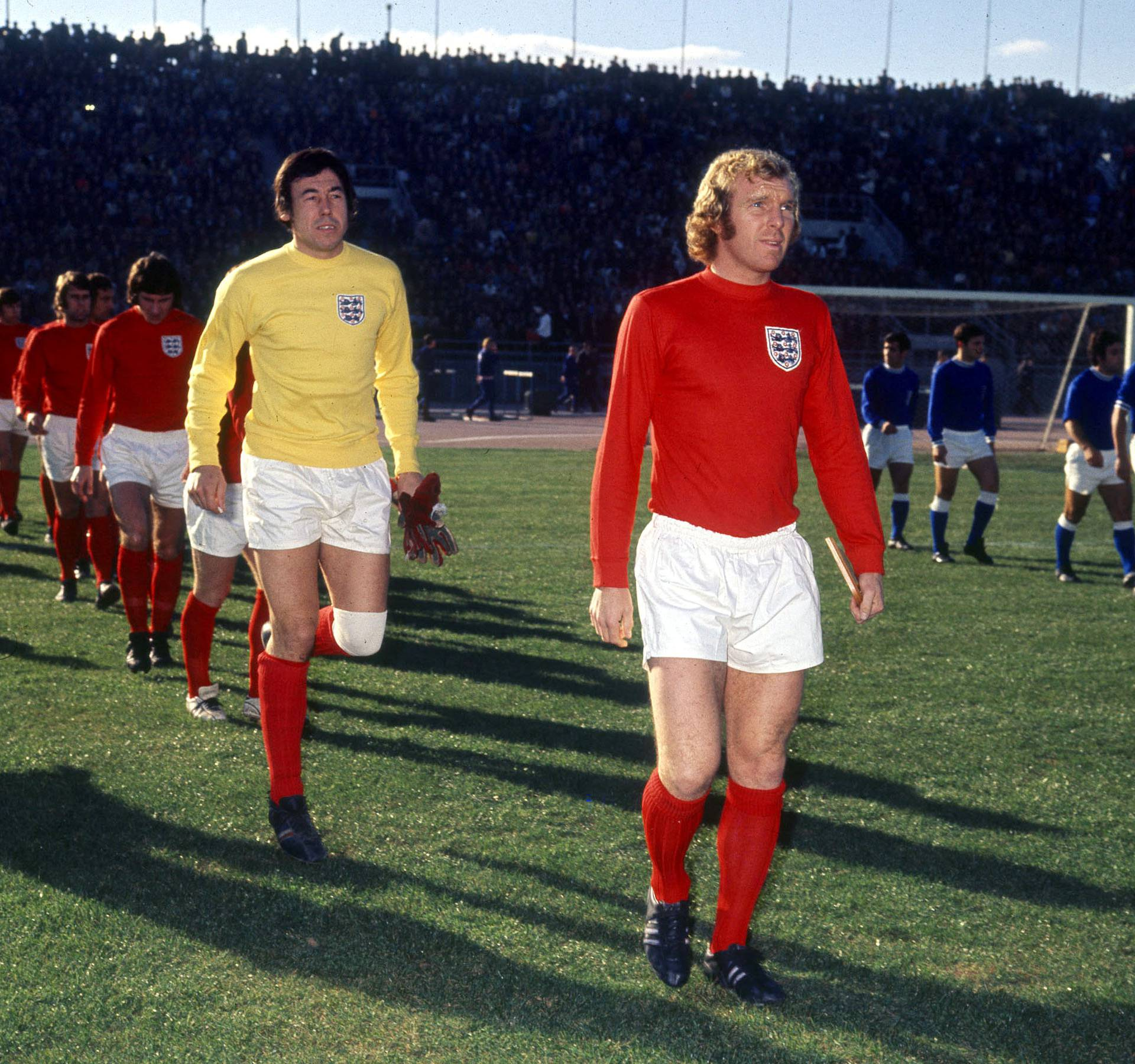 FILE PHOTO: Football - Bobby Moore leads out England followed by Gordon Banks