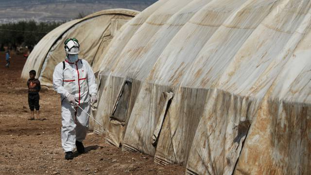 FILE PHOTO: A member of the Syrian Civil defence sanitizes a tent at the Bab Al-Nour internally displaced persons camp, to prevent the spread of coronavirus disease (COVID-19) in Azaz