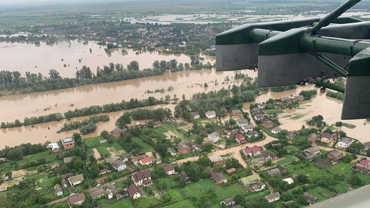An aerial view shows flooded residential buildings in Ivano-Frankivsk region