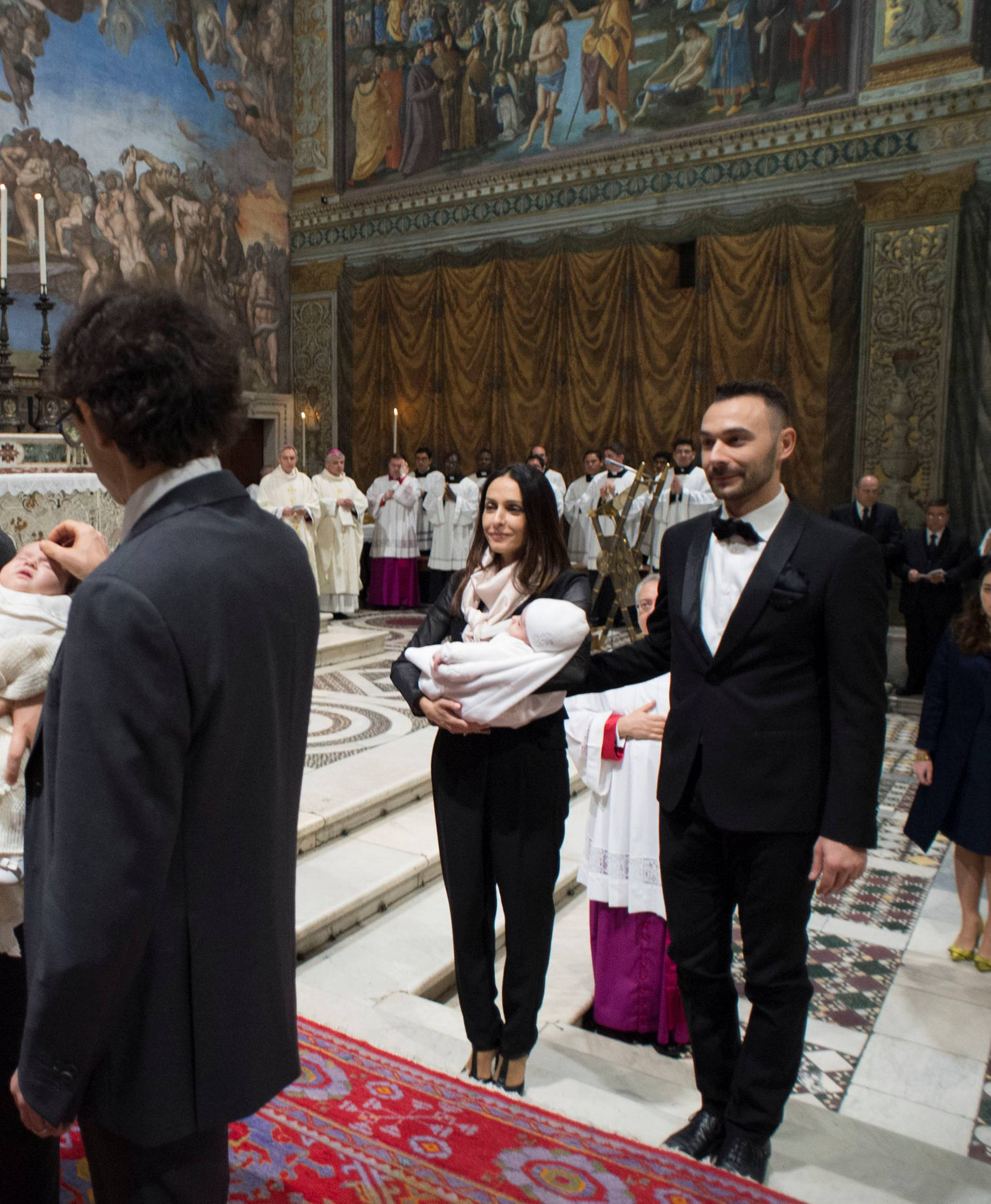 Pope Francis leads a ceremony of baptism during a solemn mass in the Sistine Chapel at the Vatican