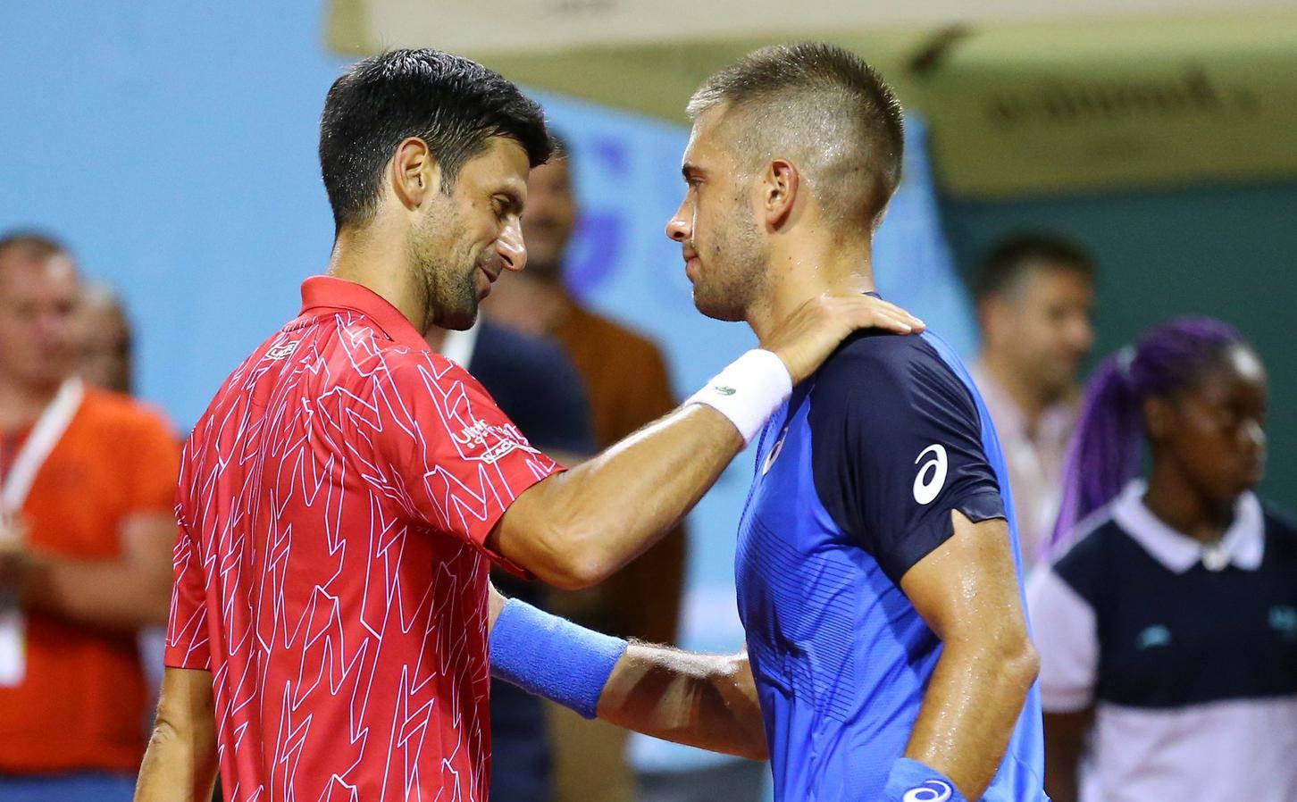 Serbia's Novak Djokovic greets with Croatia's Borna Coric after winning his match in Zadar