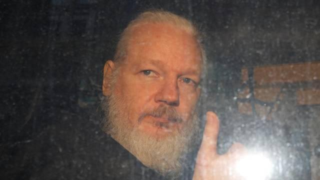 WikiLeaks founder Julian Assange is seen as he leaves a police station in London