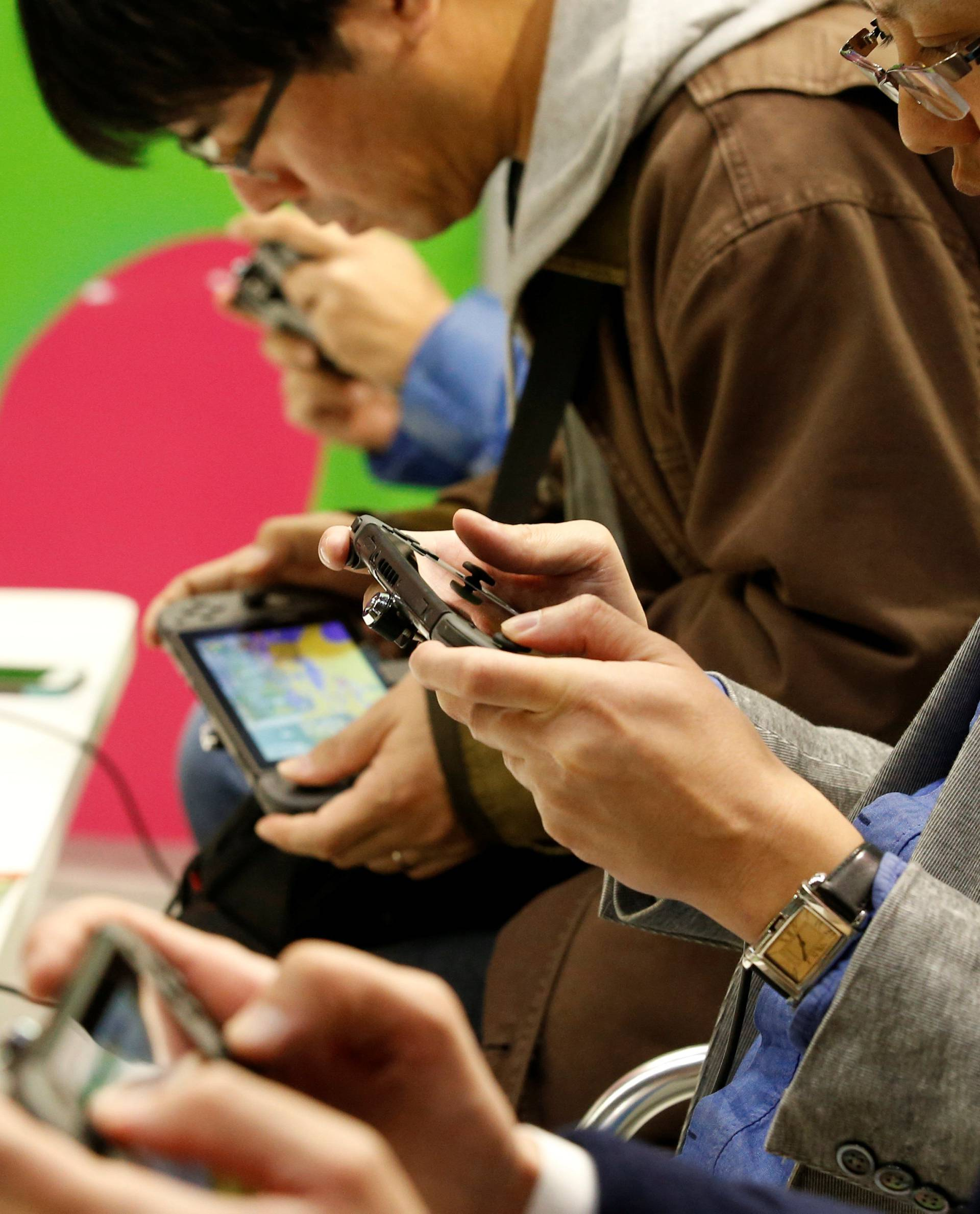 People play Nintendo's new game console Switch at its experience venue in Tokyo