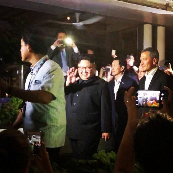 North Korea's leader Kim Jong Un waves to the crowd in Singapore