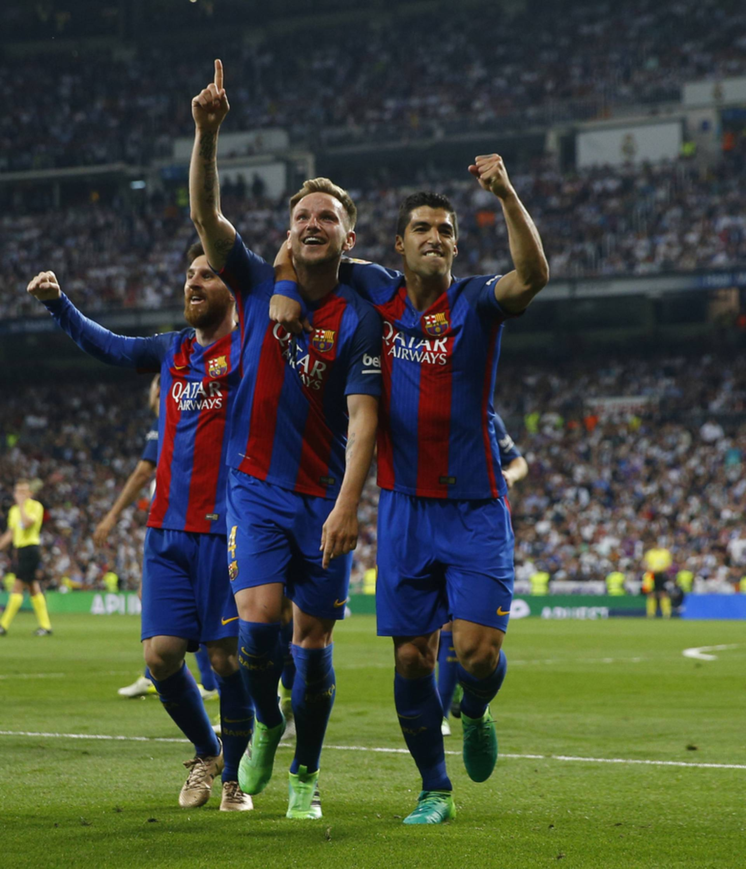 Barcelona's Ivan Rakitic celebrates scoring their second goal with team mates