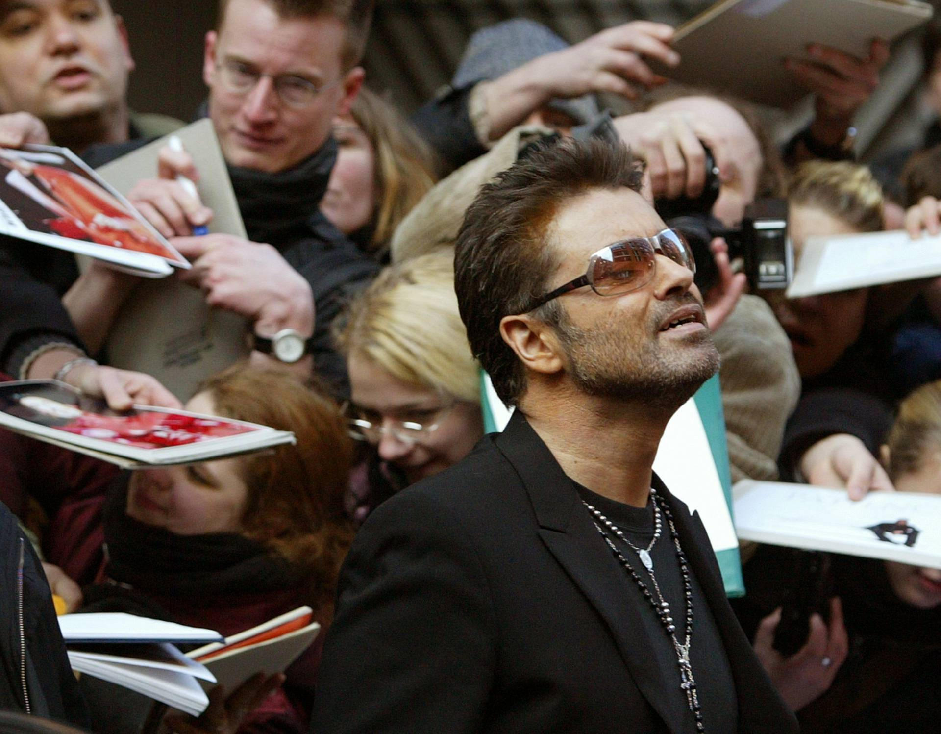 FILE PHOTO British singer and actor George Michael leaves a news conference