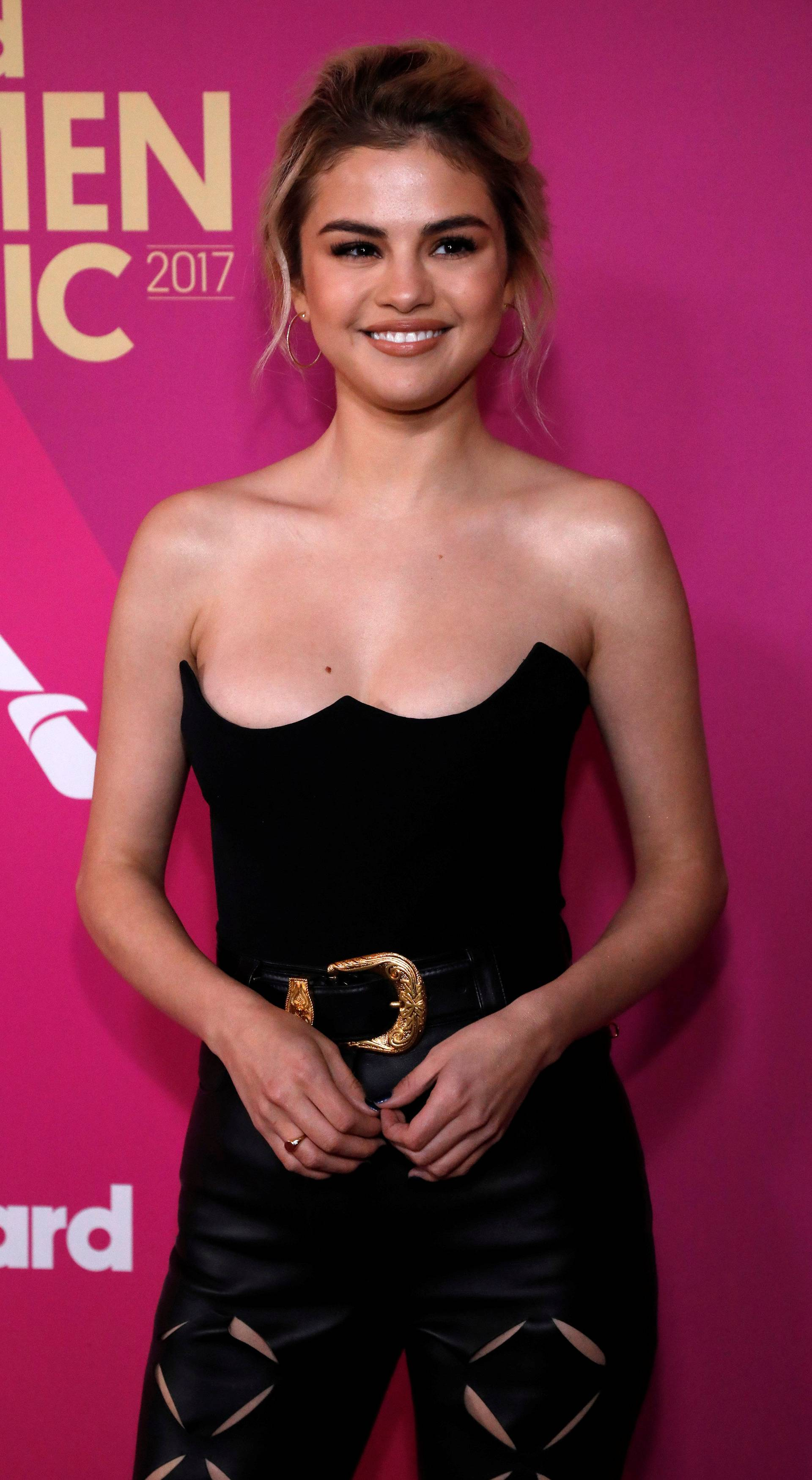 Singer Gomez poses at the Billboard Women in Music awards in Los Angeles