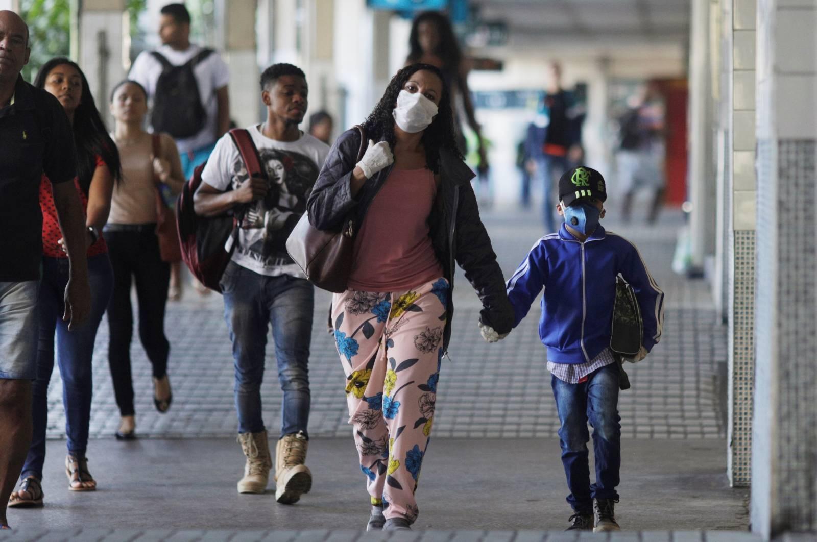 Passengers walk at Central do Brasil train station during the coronavirus disease (COVID-19) outbreak in Rio de Janeiro