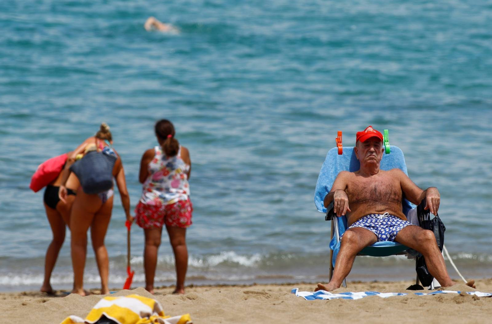 A man sunbathes on the Las Canteras beach as some Spanish provinces are allowed to ease lockdown restrictions during phase two, on the island of Gran Canaria