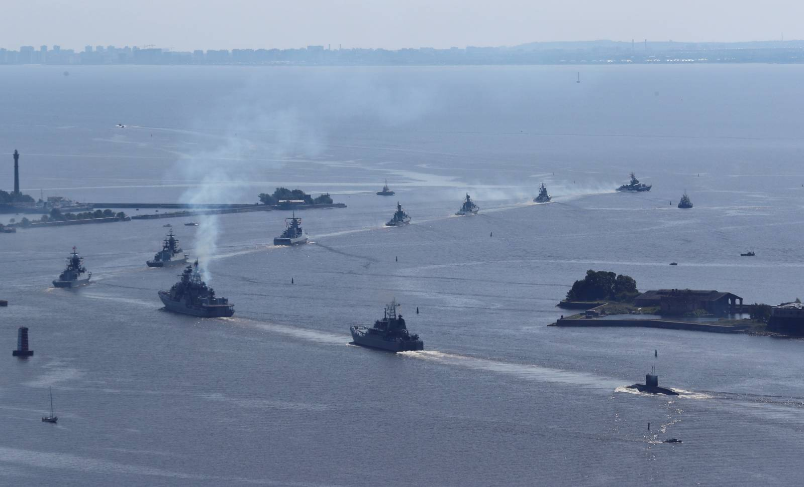 Russian warships and a military submarine sail during a rehearsal for the Navy Day parade near Saint Petersburg