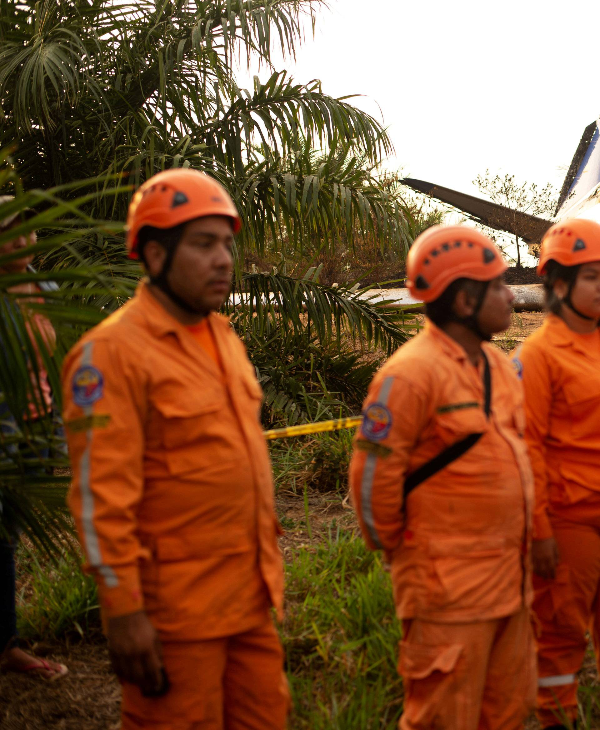 Members of the Colombian civil defense work where a plane crashed in the Colombian plains province of Meta, San Carlos de Guaroa