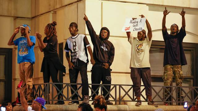 Protesters gather at the Charlotte-Mecklenburg Police Department in uptown Charlotte, NC to protest the police shooting of Keith Scott, in Charlotte