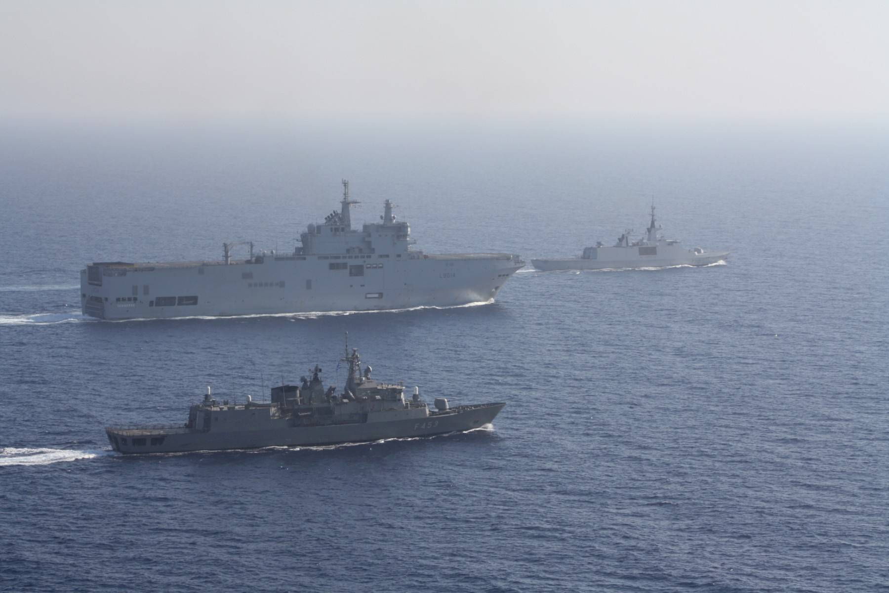 Greek and French vessels sail in formation during a joint military exercise in Mediterranean sea