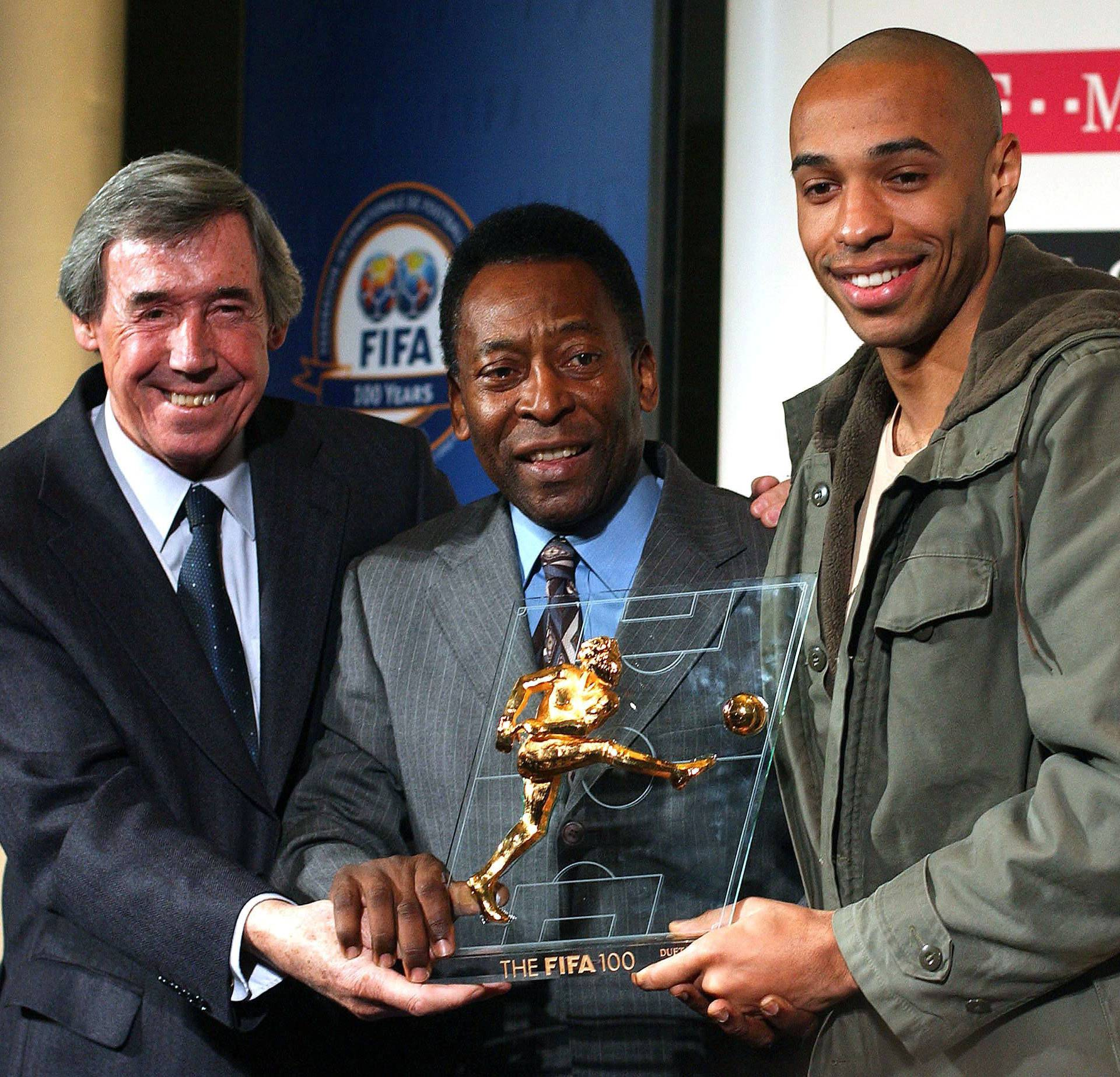 FILE PHOTO: BRAZILIAN FOOTBALL LEGEND PELE AND FORMER ENGLAND GOALKEEPER BANKS PRESENT FRENCH PLAYER HENRY WITH ...