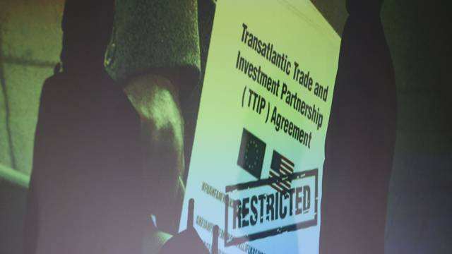 A copy of the restricted TTIP negotiations is projected to a screen during a news conference of Greenpeace in Berlin