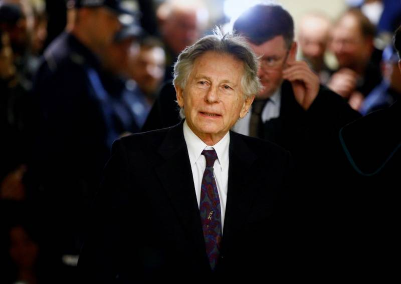 File photo of filmmaker Polanski walking on a corridor during a break of a court hearing in Krakow