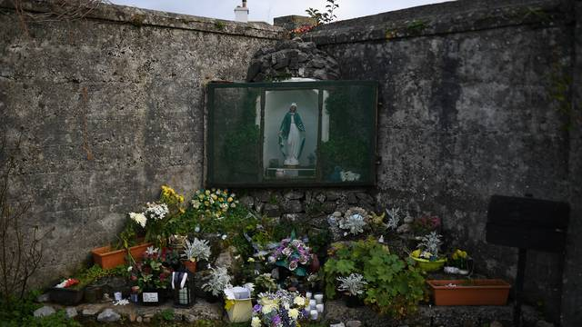 A man is seen at the site of the Tuam babies graveyard where the bodies of 796 babies were uncovered at a former Catholic home in Tuam