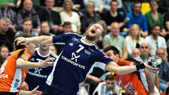 BSVs Nikolaj OEris Nielsen gets floored during the Velux EHF Handball Champions League match between BSV - Pick Szeged, Jysk Arena, Silkeborg