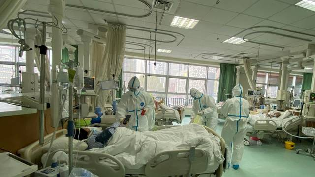 Pictures uploaded to social media on January 25, 2020 by the Central Hospital of Wuhan show medical staff attending to patients, in Wuhan, China