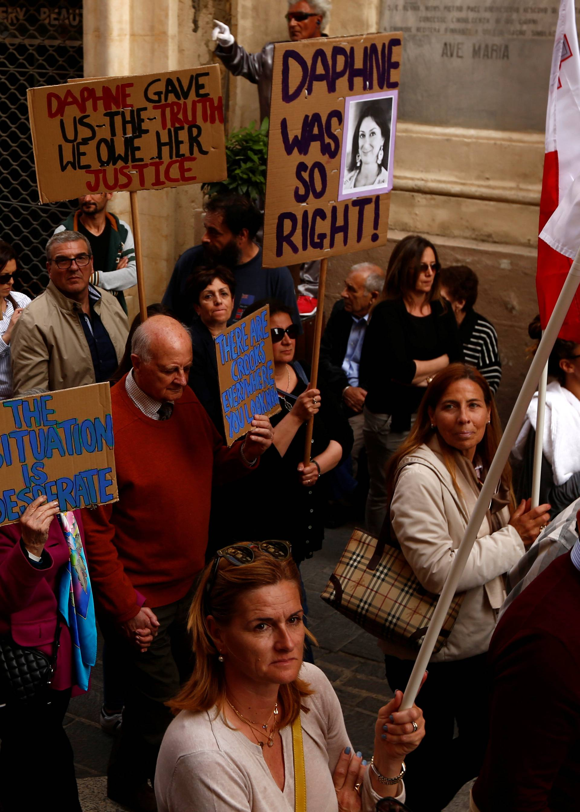 Family members of assassinated anti-corruption journalist Daphne Caruana Galizia take part in a protest against government corruption revealed by the Daphne Project, in Valletta