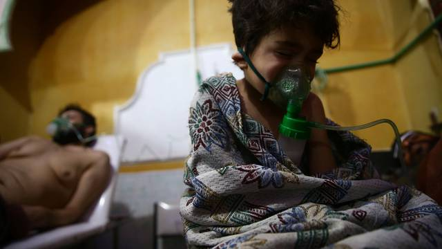 Child and man are seen in hospital in the besieged town of Douma, Eastern Ghouta, Damascus