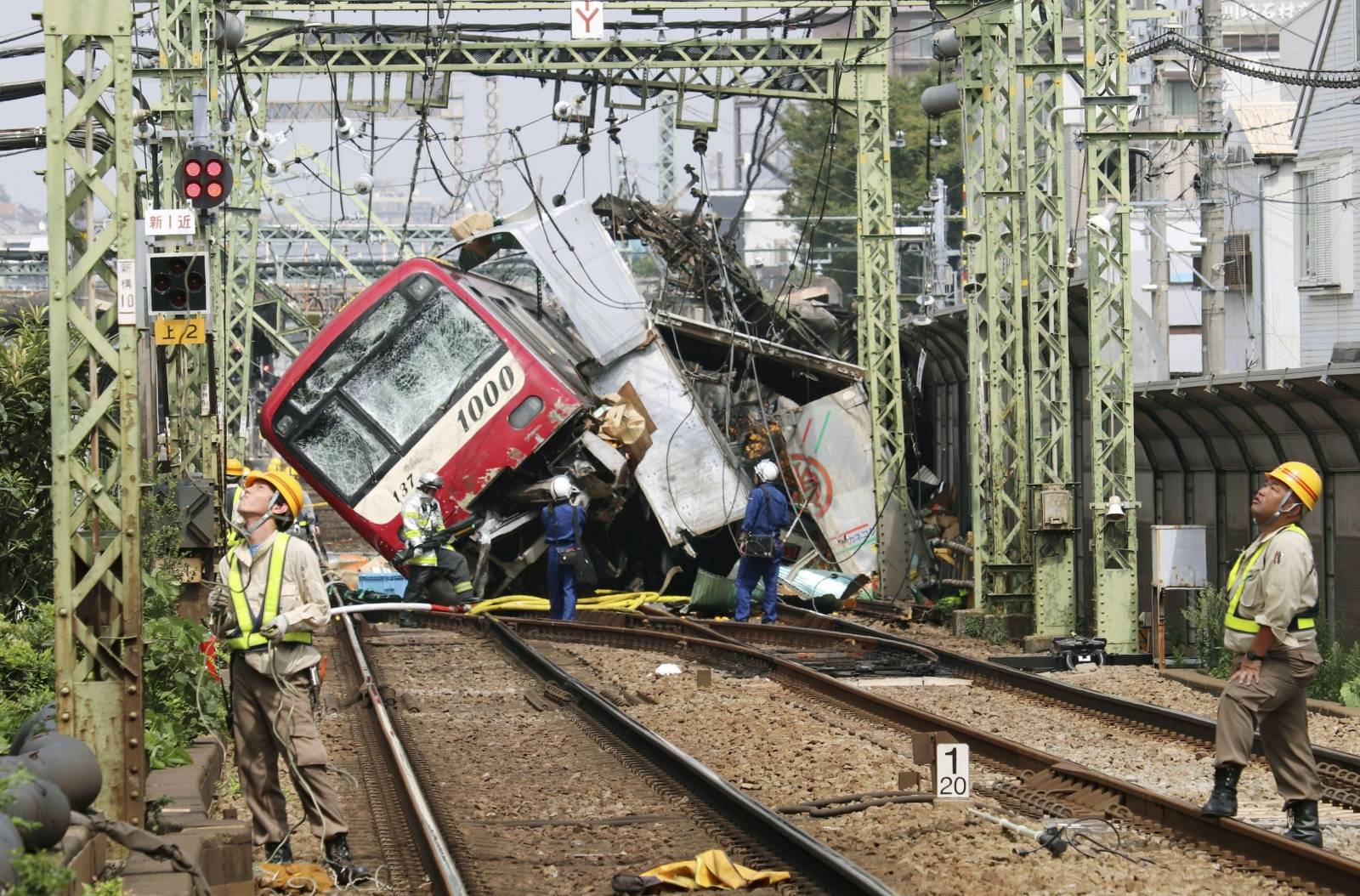 A train is seen as it is derailed after a collision with a truck in Yokohama