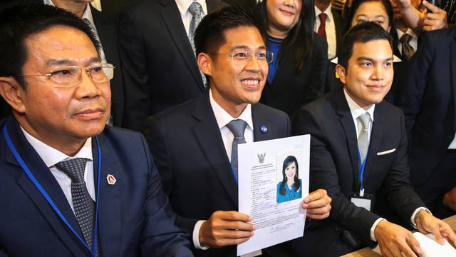 Thai Raksa Chart party leader Preechapol Pongpanich, holds up application of candidate for Prime Minister, Thailand's Princess Ubolratana Rajakanya Sirivadhana Varnavadi, at the election commission office in Bangkok