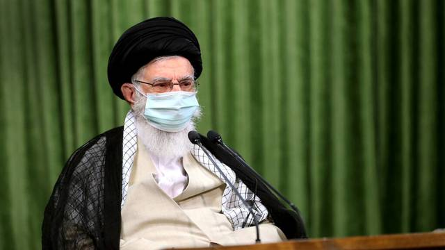 Iran's Supreme Leader Ayatollah Ali Khamenei wears a protective face mask, during a virtual meeting with lawmakers in Tehran
