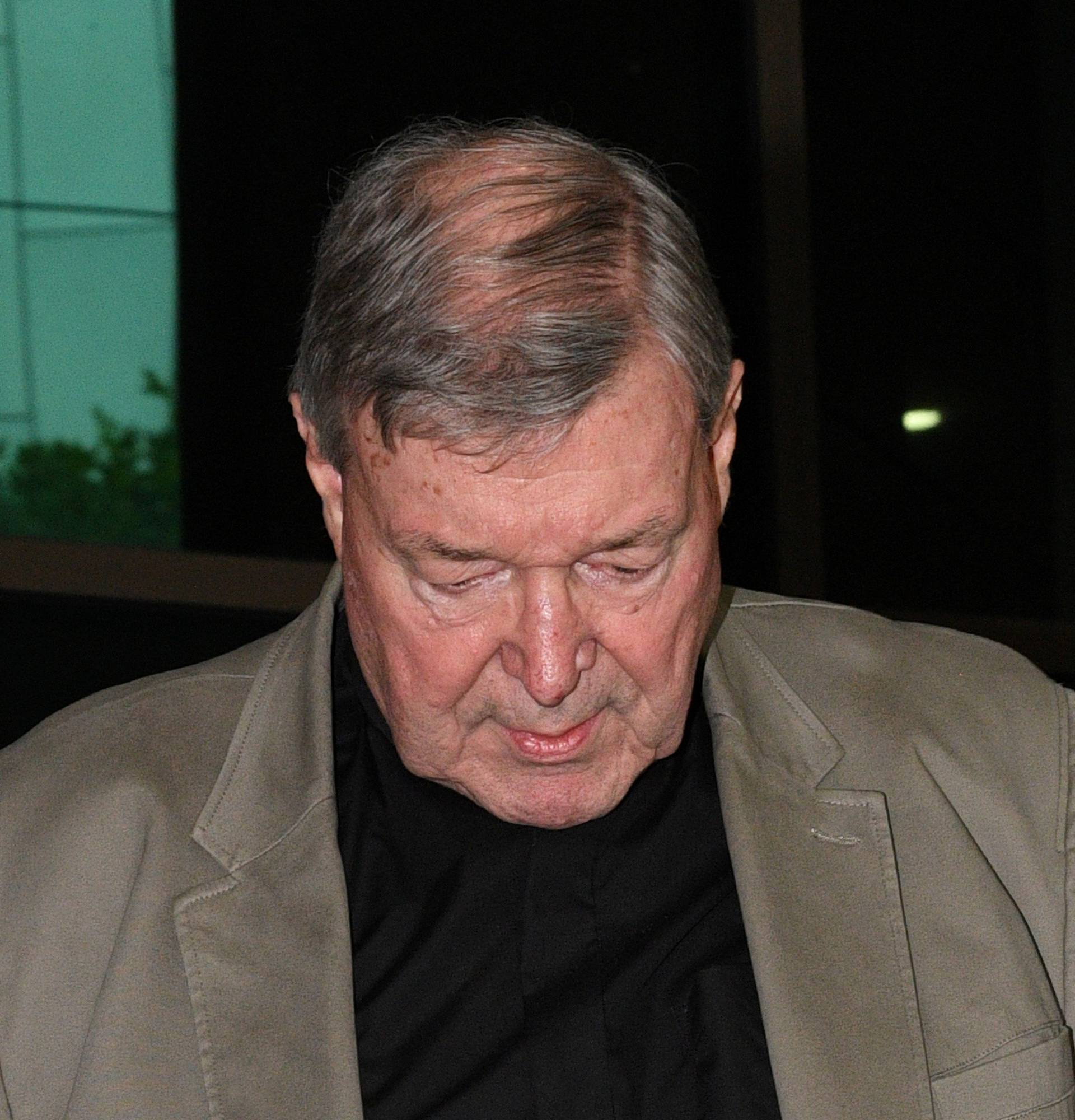 Cardinal George Pell departs the Melbourne Magistrates Court in Melbourne