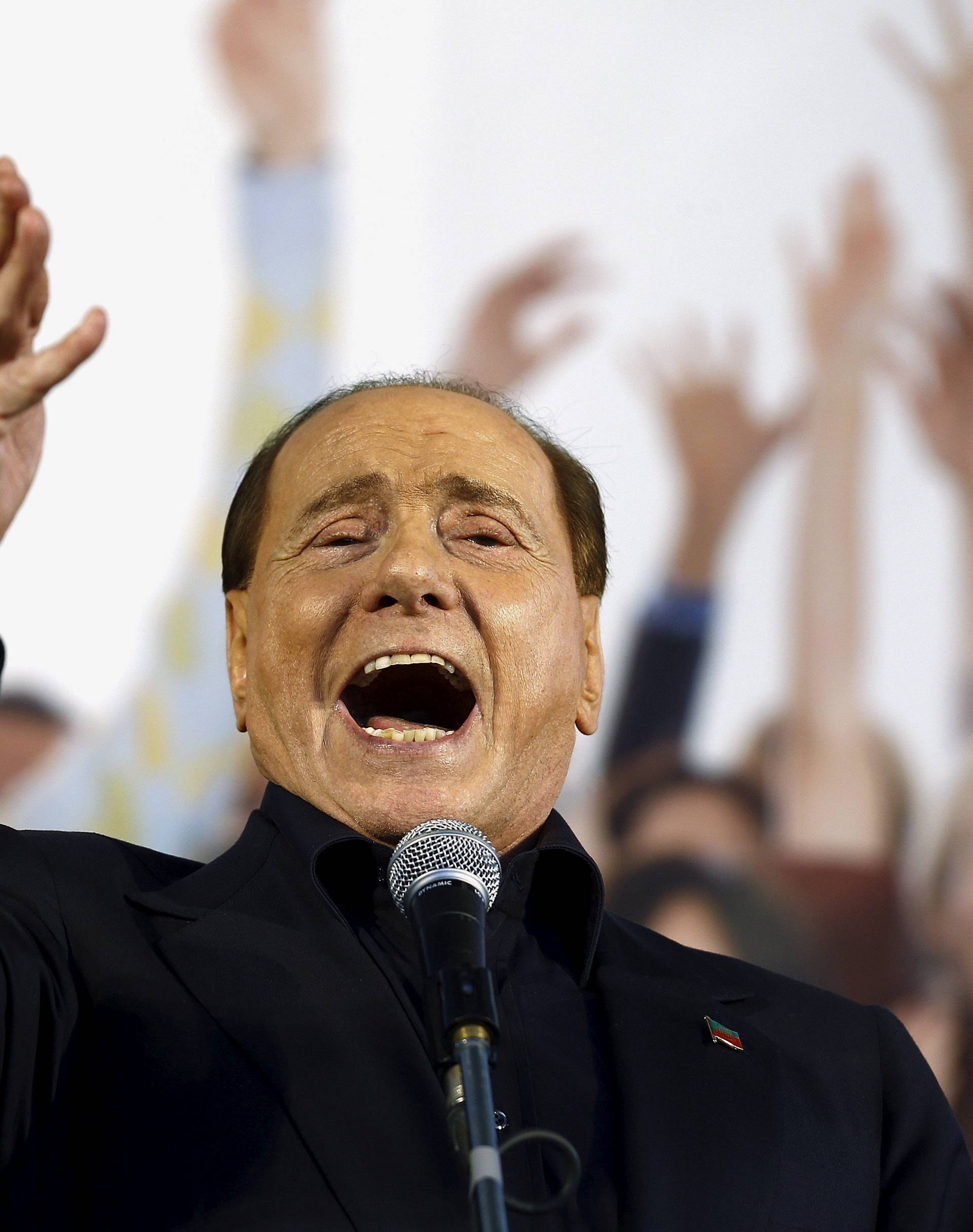 FILE PHOTO: Forza Italia party (PDL) leader Berlusconi speaks during Northern League rally in Bologna