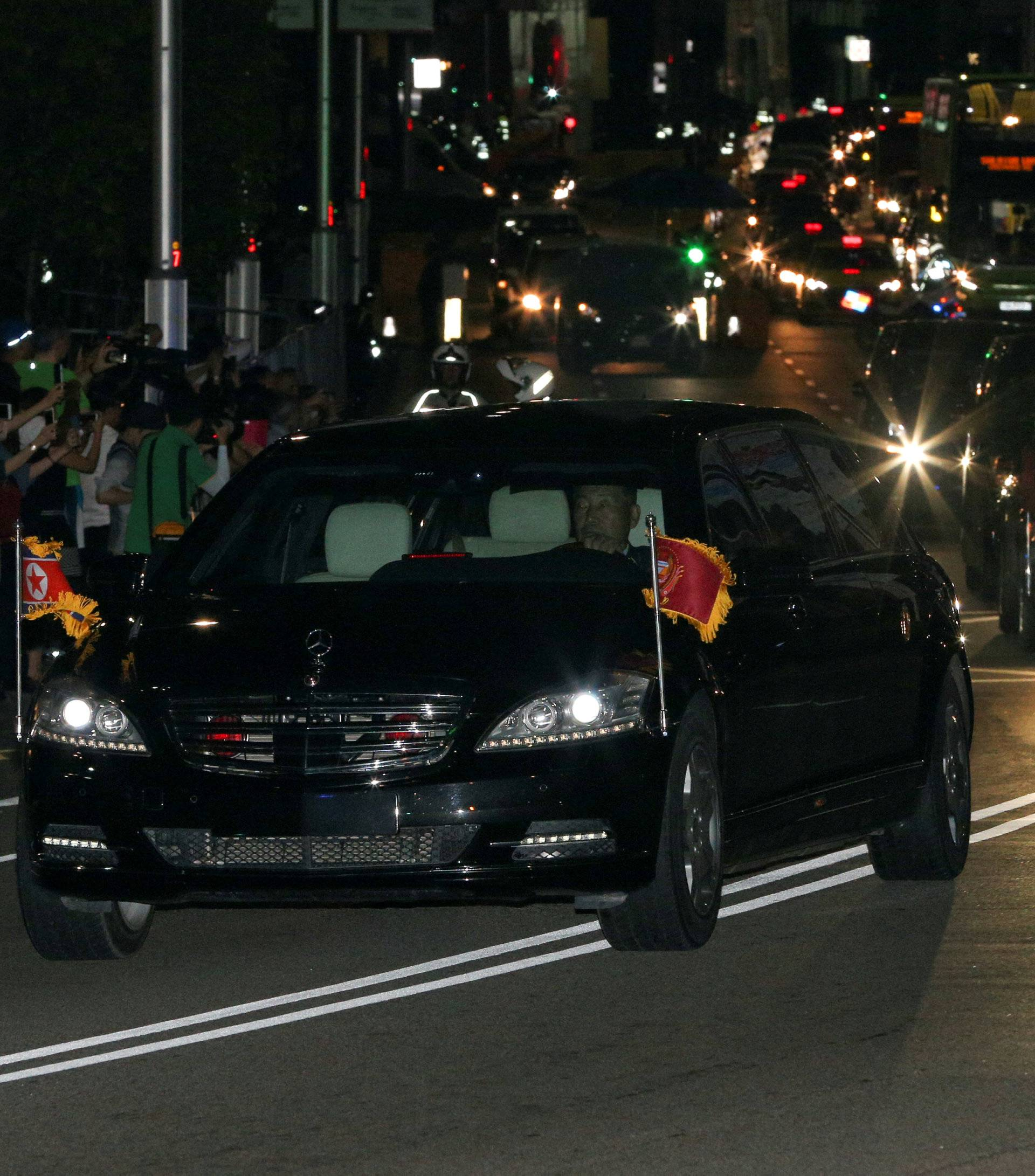 The vehicle carrying North Korean leader Kim Jong Un leaves the St Regis hotel in Singapore