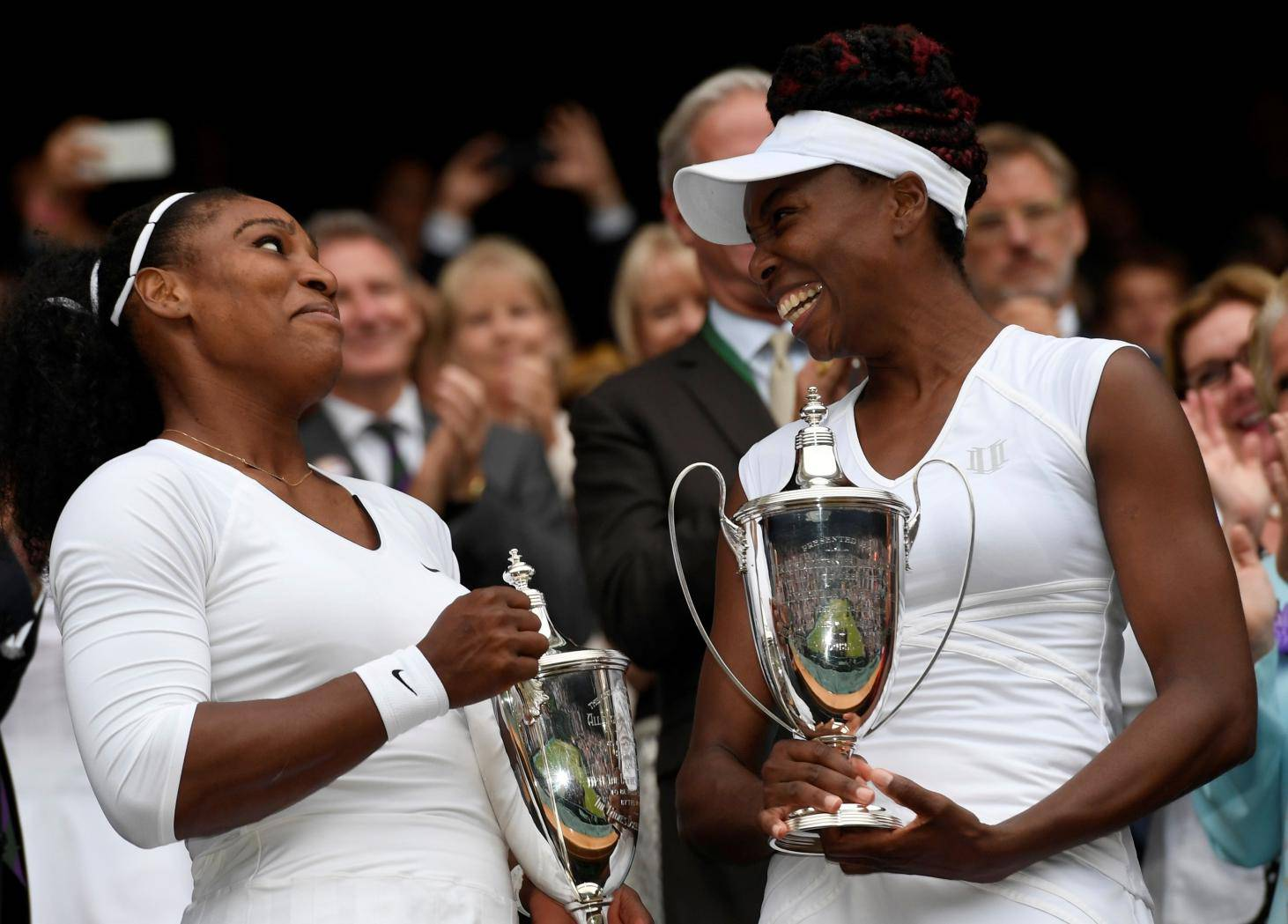 FILE PHOTO: Venus Williams celebrate winning 2016 Wimbledon women's doubles title with her sister Serena Williams