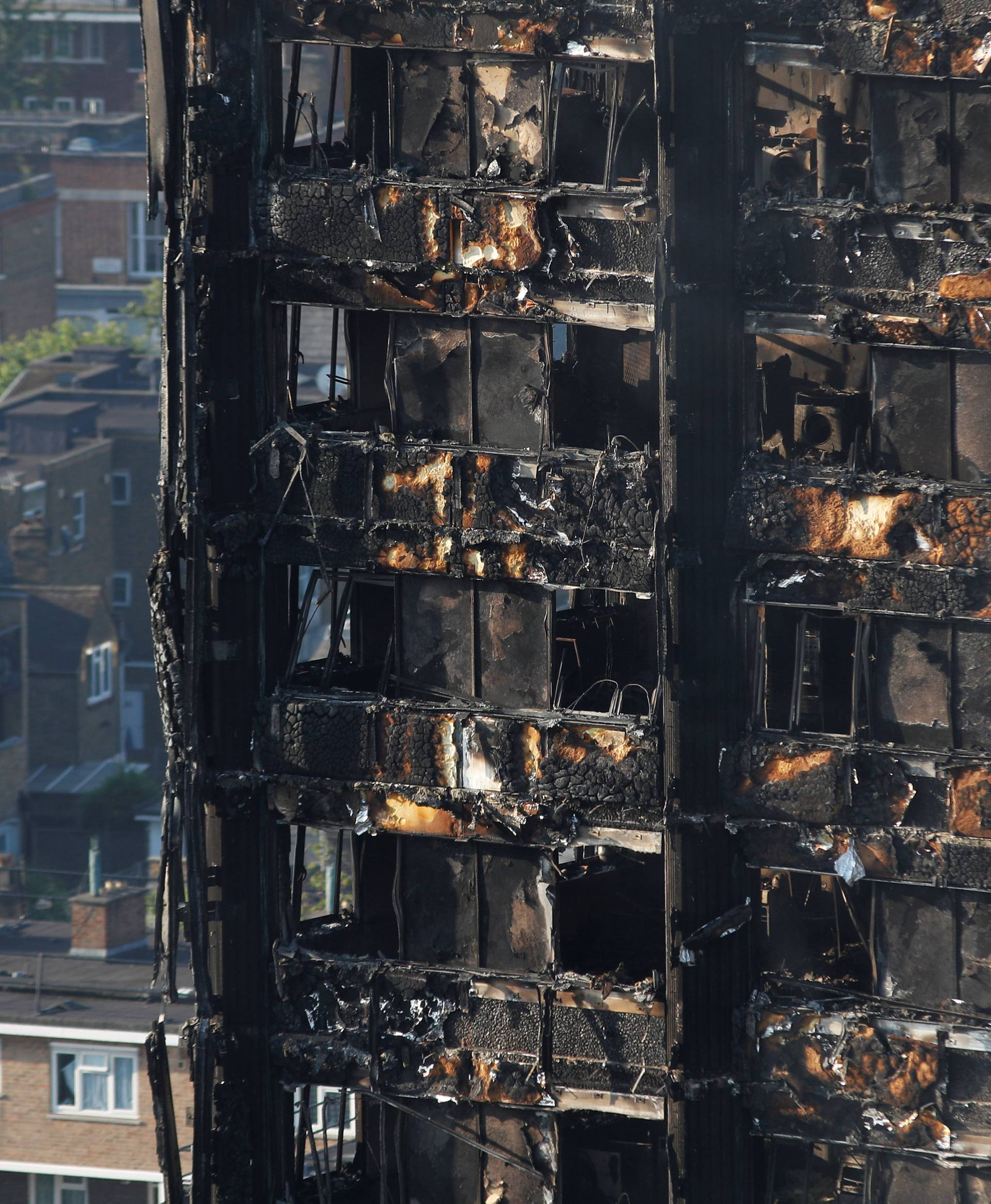 Damage is seen to a tower block which was destroyed in a fire disaster, in north Kensington, West London