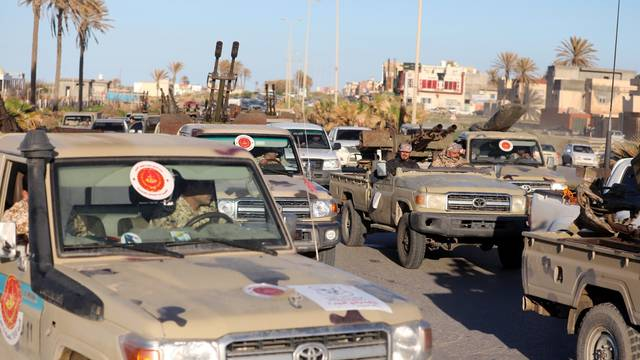 Military vehicles of Misrata forces, under the protection of Tripoli's forces, are seen in Tajura neighborhood, east of Tripoli