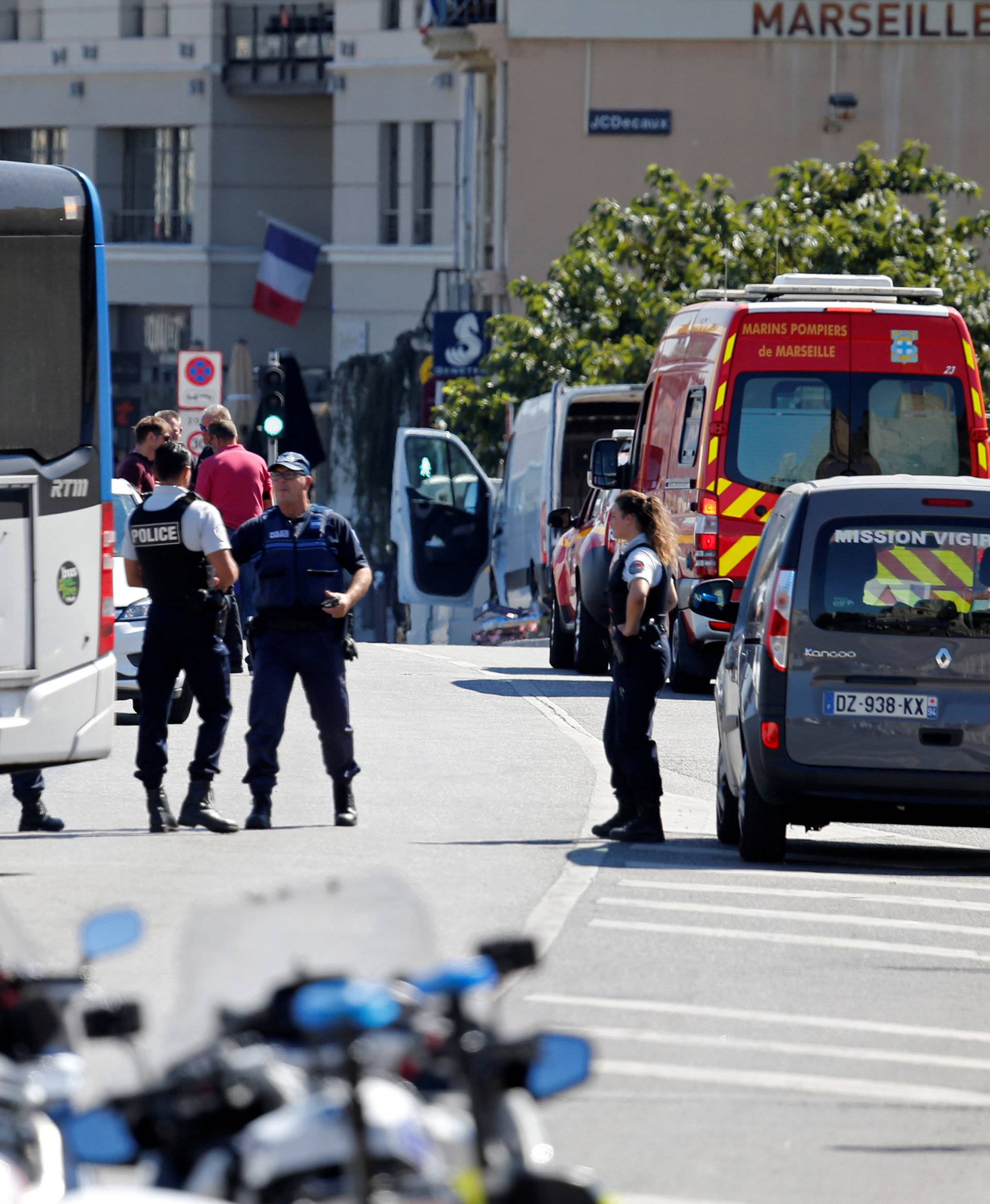 French police secure the area in the French port city of Marseille where one person was killed and another injured after a car crashed into two bus shelters