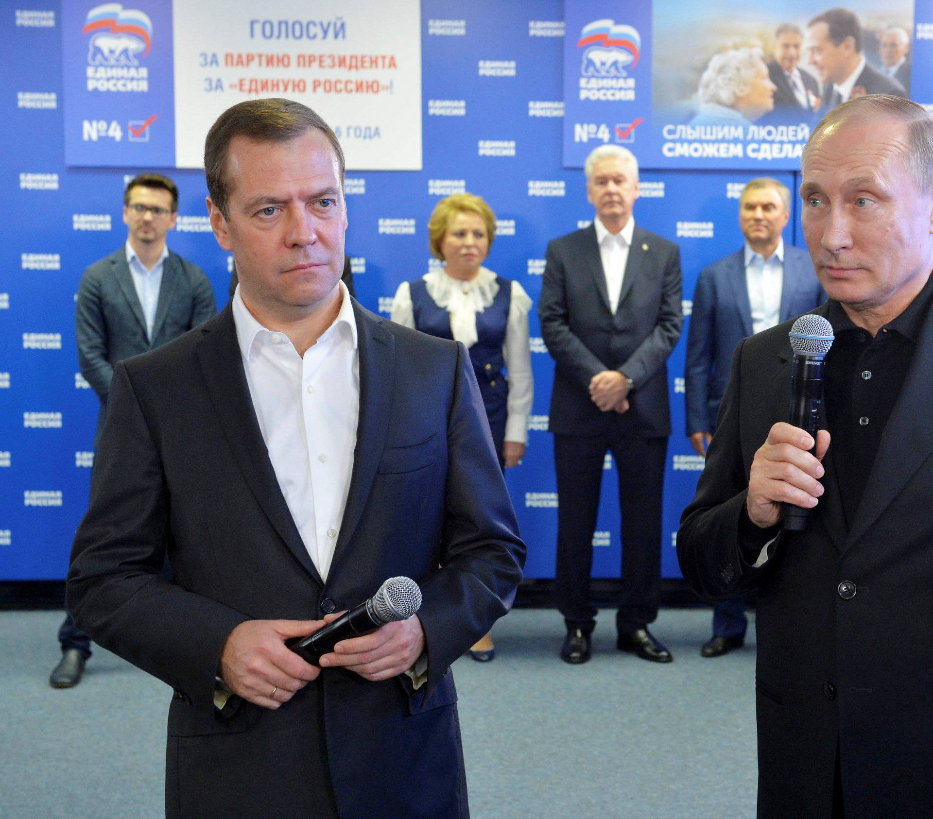 Russian President Vladimir Putin and Prime Minister and Chairman of the United Russia party Dmitry Medvedev visit the party's campaign headquarters following a parliamentary election in Moscow